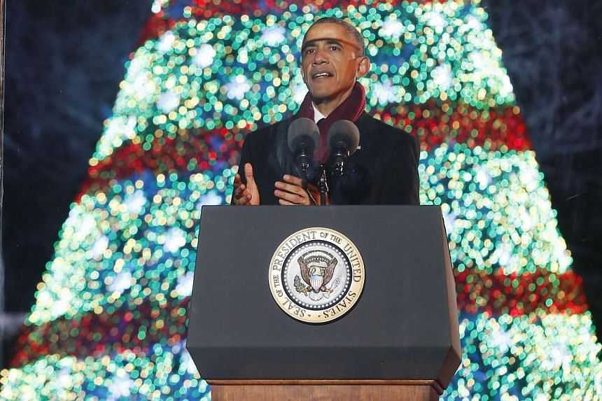 US President Barack Obama speaks after lighting the National Christmas Tree on the Ellipse near the White House in Washington, DC on Dec 4, 2014. -- PHOTO: REUTERS