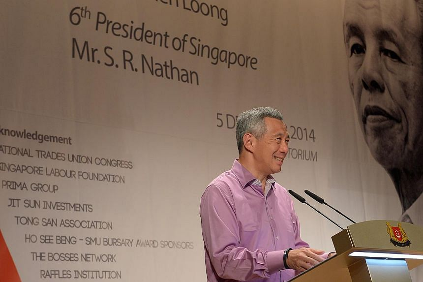 """The 140-page book """"Ho See Beng: The Washerwoman's Son"""" was launched on Friday by Prime Minister Lee Hsien Loong and former president S.R. Nathan at the NTUC headquarters at Shenton Way. -- ST PHOTO: DESMOND WEE"""