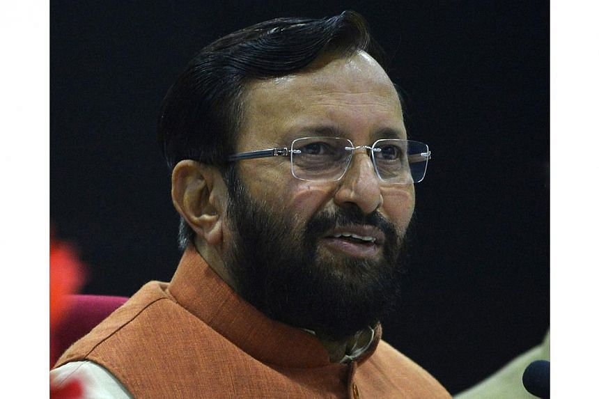 Prakash Javadekar, Indian Union Minister for Environment and Forests, speaks to media at a press conference in New Delhi on Dec 5, 2014. India will not sign any deal to cut greenhouse gas emissions at UN climate talks that threatens its growth or und