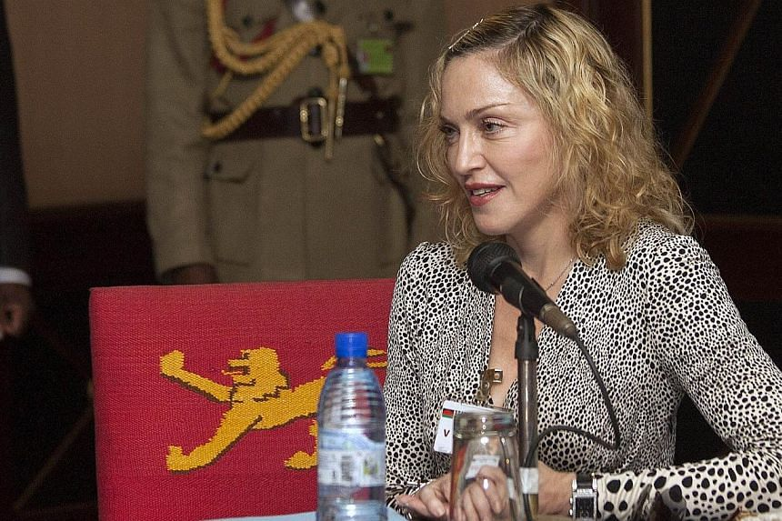 US pop star Madonna making a statement on Nov 28, 2014, after her meeting with Malawi's President, Professor Peter Mutharika, at the Kamuzu Palace in the Capital Lilongwe.The Versace fashion house announced on Dec 4, 2014, that it has chosen Madonna,