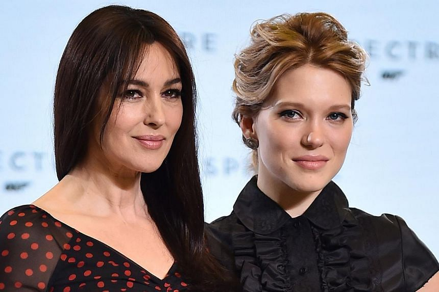French actress Lea Seydoux (right) and Italian star Monica Bellucci (left) pose during an event to launch the 24th James Bond film Spectre at Pinewood Studios at Iver Heath in Buckinghamshire, west of London, on Dec 4, 2014. -- PHOTO: AFP