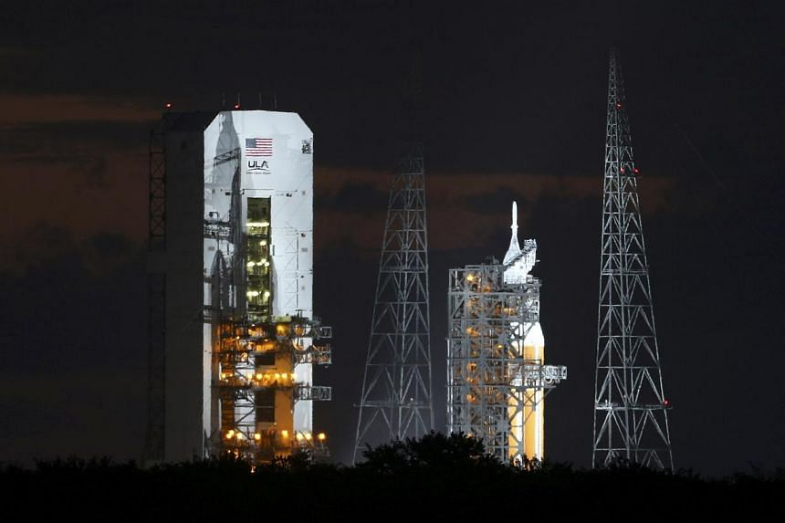 The Delta IV Heavy rocket carrying the Orion spacecraft sits on the launch pad awaiting lift off from the Cape Canaveral Air Force Station in Cape Canaveral, Florida on Dec 5, 2014. -- PHOTO: REUTERS
