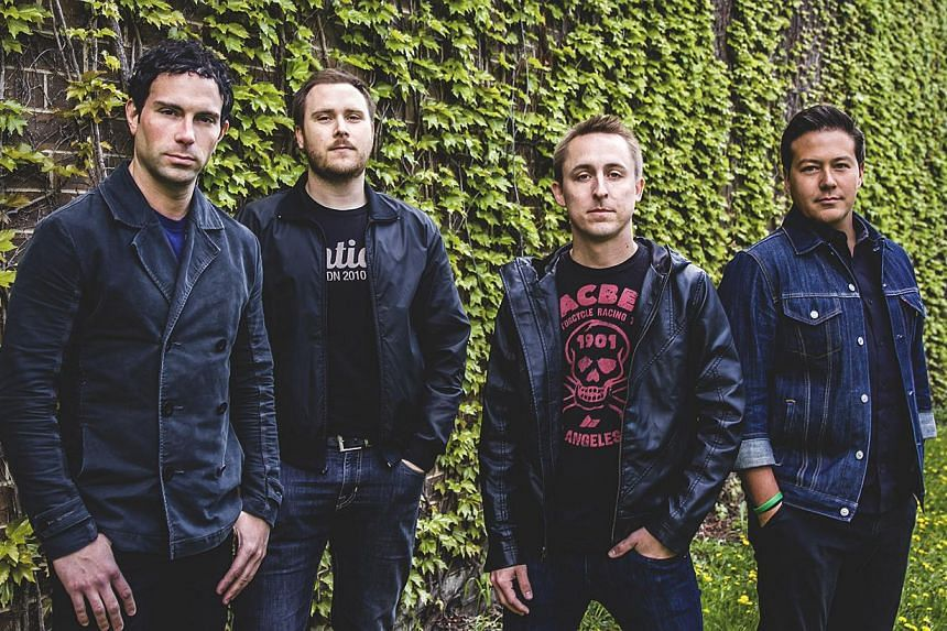 (From left) Bassist Josh Portman, guitarist Ryan Mendez, frontman Ryan Key, and violinist Sean Mackin of US pop punk band Yellowcard. The band will be performing in Singapore this week. -- PHOTO:RAZOR & TIE RECORDS