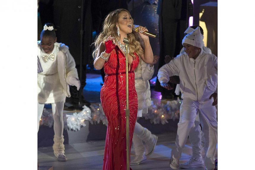 Singer Mariah Carey performs at the lighting ceremony for the 82nd Rockefeller Centre Christmas tree, in midtown Manhattan, New York City, Dec 3, 2014. -- PHOTO: REUTERS