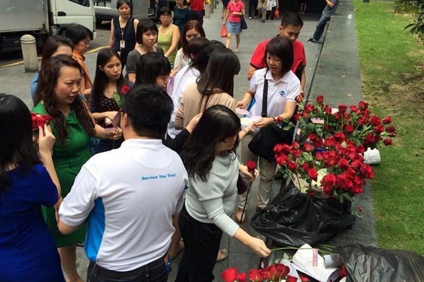 Salesmen gave out 10,000 roses to potential buyers of The Amore at Shenton Way and Orchard on Nov 26, 2014. -- PHOTO: PROPNEX REALTY