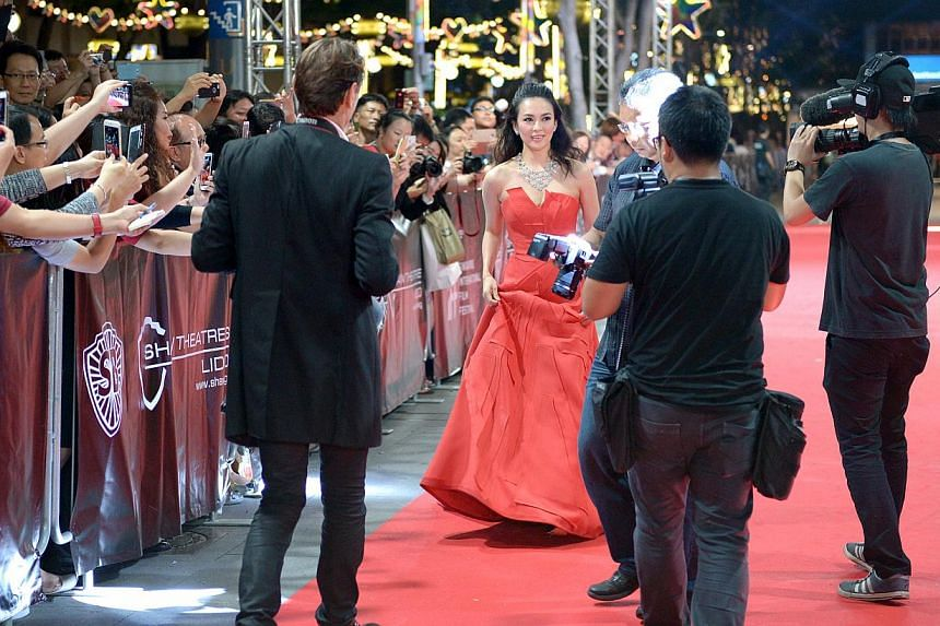 Actress Zhang Ziyi arrives at the Singapore International Film Festival at Shaw House on Dec 4, 2014. -- ST PHOTO: LIM SIN THAI