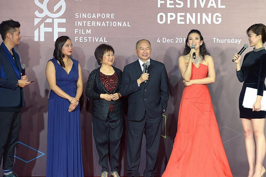 At the opening of the Singapore International Film Festival are director John Woo (fourth from left) with his wife Annie Woo (third from left), daughter Angeles Woo (second from left) and actress Zhang Ziyi (fifth from left), at Shaw House, Dec 4, 20
