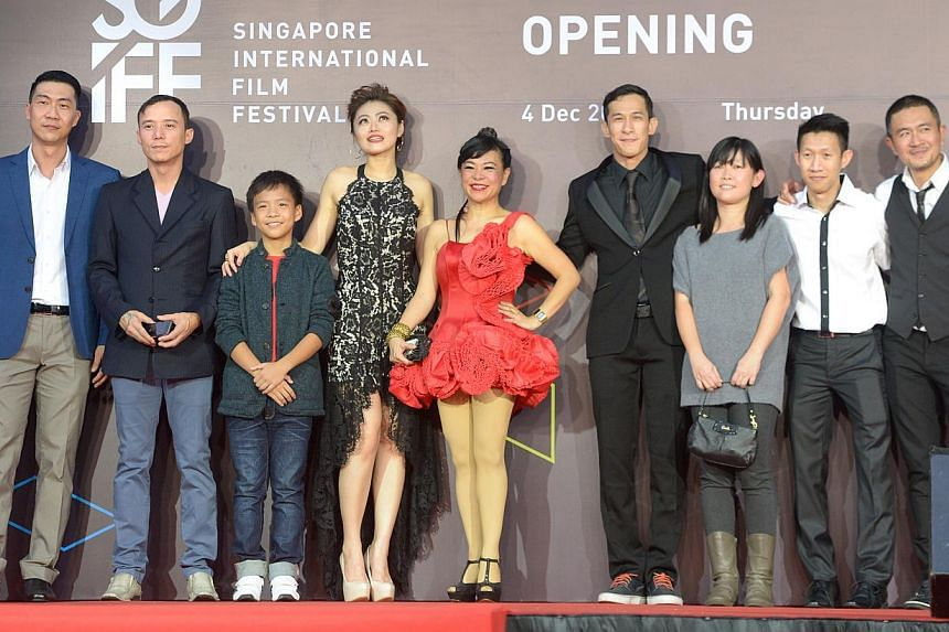 Director Ken Kwek (left) with his Unlucky Plaza team at Shaw House on Dec 4, 2014. -- ST PHOTO: LIM SIN THAI