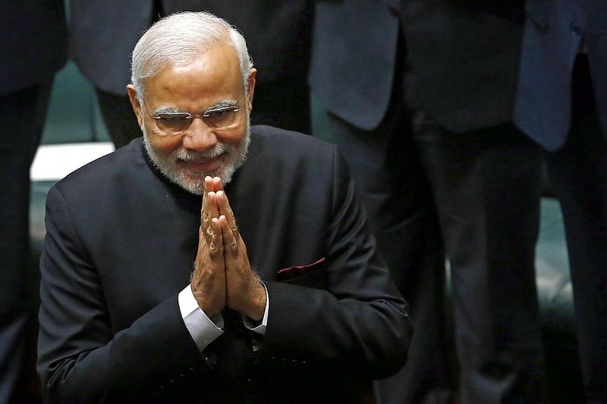 India's Prime Minister Narendra Modi enters the House of Representatives to make a speech in Australia's Parliament House in Canberra on Nov 18, 2014. -- PHOTO: REUTERS