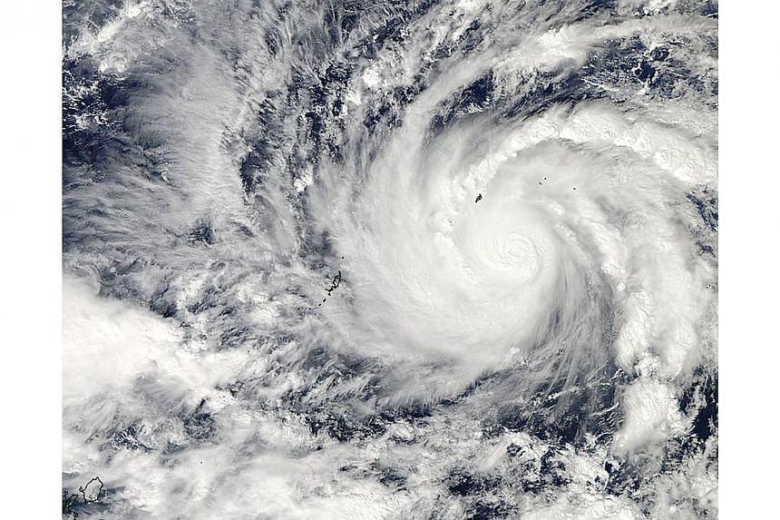 Typhoon Hagupit in the western Pacific Ocean is captured by NASA's Aqua satellite December 3, 2014 , in this handout image provided by NASA. Residents of coastal villages and landslide-prone communities were told to move to government-designated evac