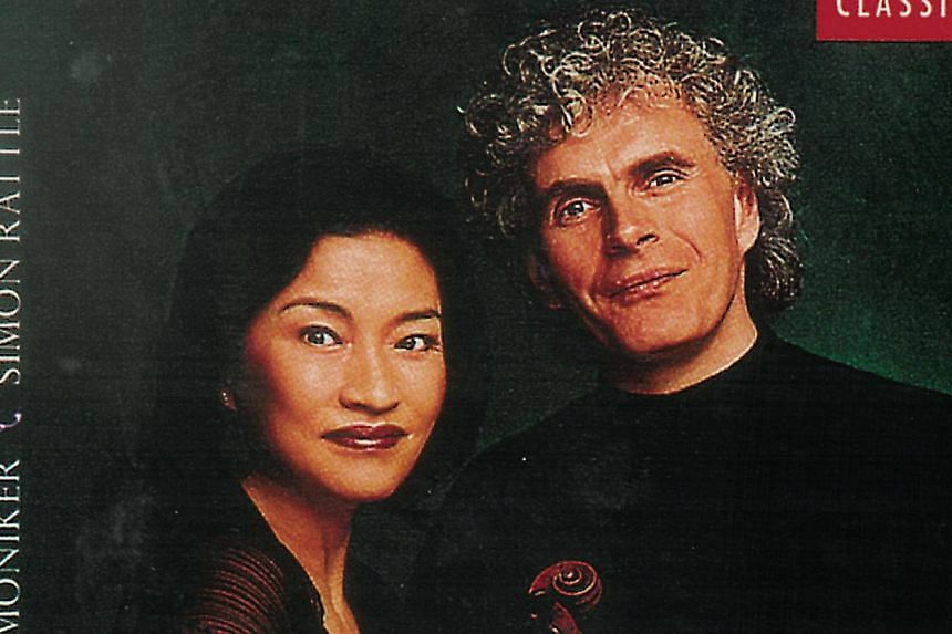 Korean violinist Kyung Wha Chung on an album cover with conductor Simon Rattle.  A comeback concert by Kyung Wha Chung after more than a decade away due to a finger injury struck a sour note with the British press after she reportedly upbra