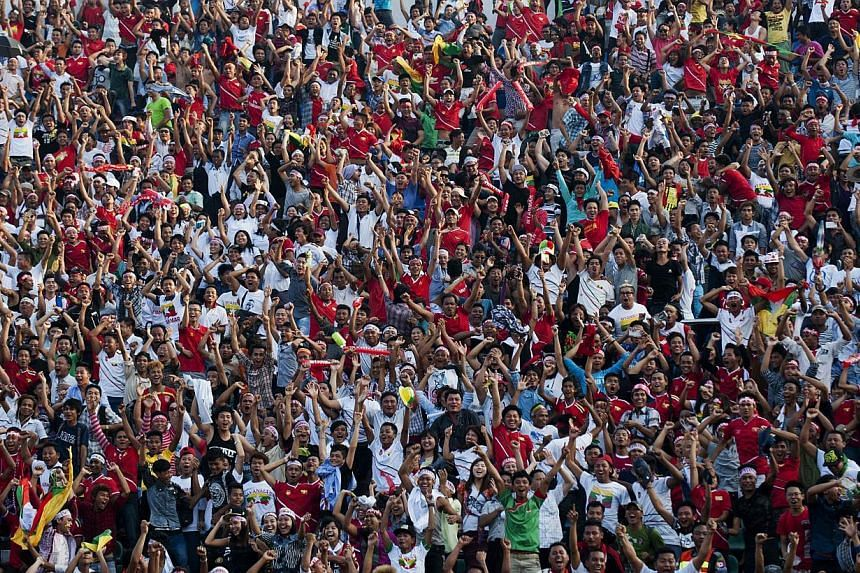 Myanmar will have to play its next match behind closed doors as punishment for a pitch invasion during an October game,the Asian Football Confederation (AFC) said on Saturday. -- PHOTO: AFP