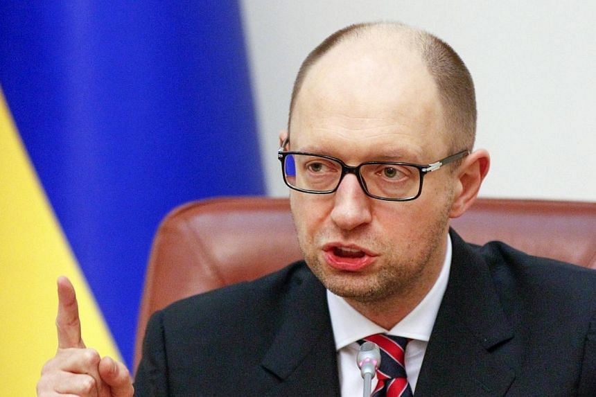 Ukraine's Prime Minister Arseny Yatseniuk speaks during a government meeting in Kiev on Dec 3, 2014. An International Monetary Fund mission will visit Kiev from December 9 to 18 for talks with the new government regarding a $17 billion bai