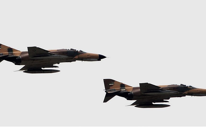 F-4 Phantom fighter jets flying during the Army Day parade in the Iranian capital Tehran on April 18, 2010.A senior Iranian official has confirmed his country carried out air strikes in neighbouring Iraq against the Islamic State in Iraq and Sy