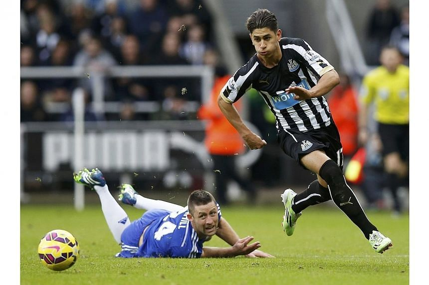 Newcastle's Ayoze Perez runs past Chelsea's Gary Cahill during their English Premier League match at St James' Park on Dec 6, 2014. -- PHOTO: REUTERS