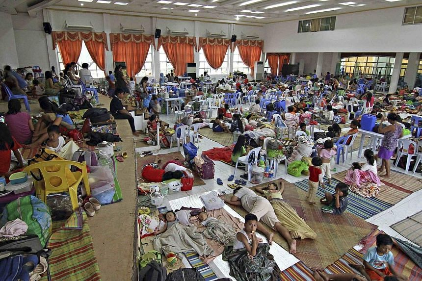 People take shelter in an evacuation centre after leaving their homes in Surigao city in the southern Philippines, where Typhoon Hagupit is expected to make landfall. -- PHOTO: REUTERS