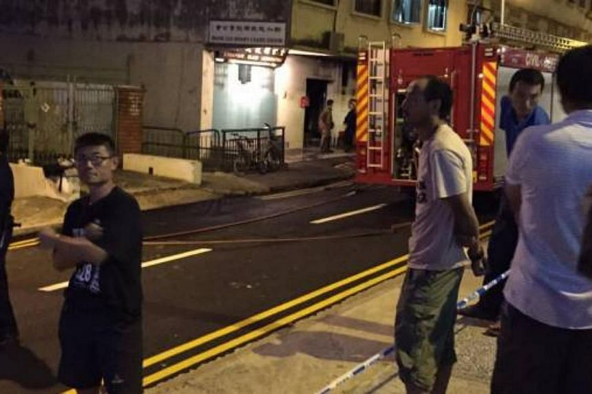 Three people were killed after a fire broke out early this morning at a workers' shophousein Geylang Lorong 4. --PHOTO: THE NEW PAPER