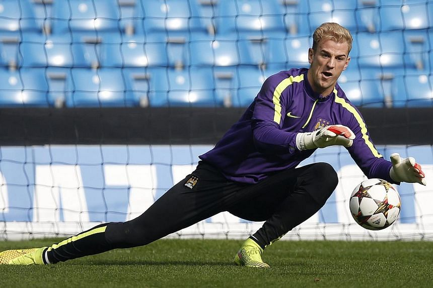 Manchester City's Joe Hart takes part in a training session at Etihad Stadium in Manchester, northern England on Sept 29, 2014. -- PHOTO: REUTERS