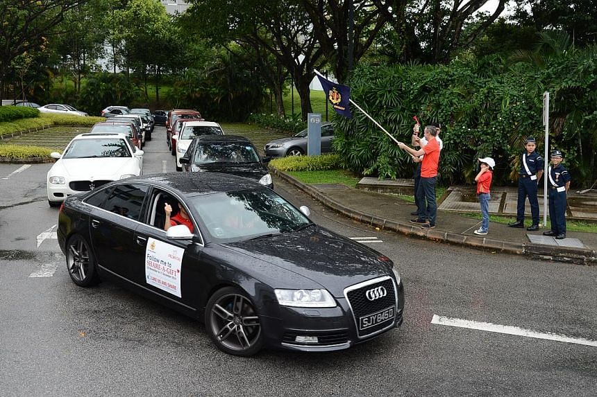 Over 100 volunteer vehicles from Prudential Singapore hit the roads to deliver the food hampers after Prudential Singapore executive vice-president and chief agency officer Jon Sandham flagged off the cars with Boys' Brigade vice-president (programme