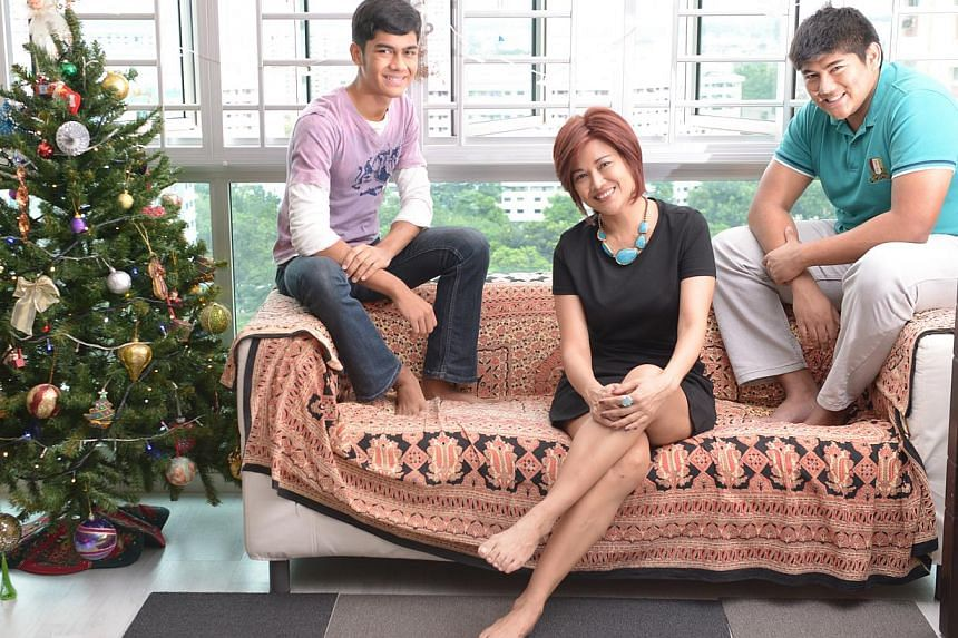 Former Miss Singapore Universe-turned-image consultant Marion Nicole Teo – seen with her two sons, Jared (left) and Jordan – shares her healing journey through her self-help book. -- ST PHOTO: LIM SIN THAI
