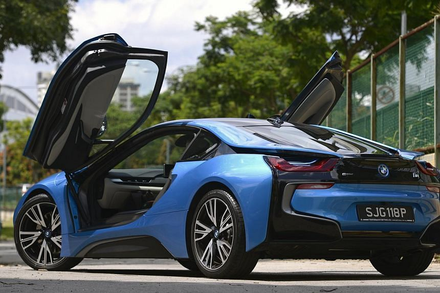 Take off in the plug-in petrol-electric BMW i8 without any feelings of guilt.
