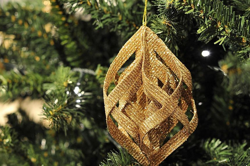 Glitter Ribbon Champagne Drop Ornament. -- PHOTO: DIOS VINCOY JR FOR THE STRAITS TIMES
