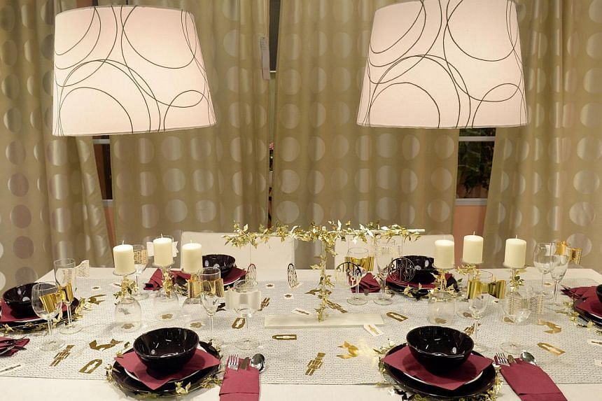 Glam up the dining table with garlands wrapped around the largest plates and bows tied to glassware (above).