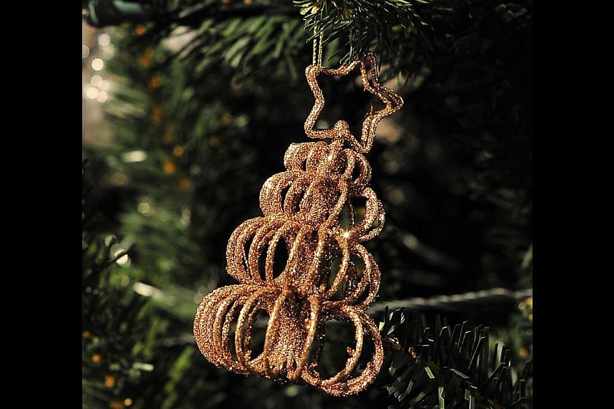 Curl Tree Gold Placecard Holder-Ornament. -- PHOTO: DIOS VINCOY JR FOR THE STRAITS TIMES