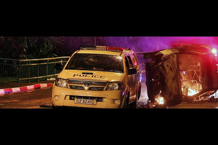One of the vehicles which were torched during the Little India riot on Dec 8 last year. A mob of about 400 people had turned violent and attacked emergency vehicles responding to a fatal accident. -- ST PHOTO: MARK CHEONG