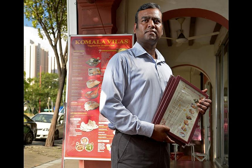 Mr T. Richerd Leo, manager of Komala Vilas Vegetarian Restaurant in Race Course Road, says business has fallen by up to 30 per cent. -- ST PHOTO: DESMOND WEE