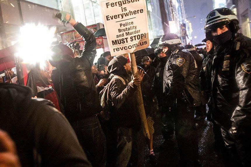 Demonstrators protest the Staten Island after a New York grand jury's decision not to indict a police officer involved in the chokehold death of Eric Garner in July on Dec 5, 2014 in New York City. -- PHOTO: AFP