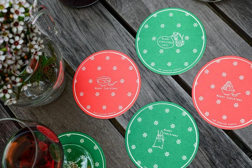 Christmas coasters featuring drinks and dishes unique to Singapore. -- PHOTO: THE COASTER PEOPLE