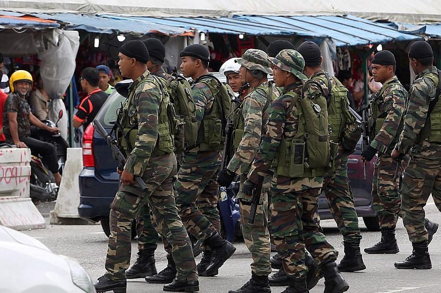 Police are keeping tab on the Malaysian armed forces as several personnel have been detected to be sympathisers of the Islamic State in Iraq and Syria (ISIS) militant group waging war in the Middle East. -- PHOTO: THE STAR PUBLICATION
