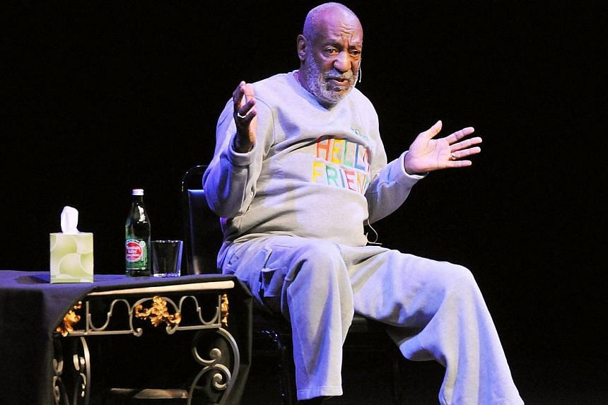 "Bill Cosby performing in Melbourne, Florida, in November 2014. A vandal scrawled the word ""rapist"" on Bill Cosby's star on the Hollywood Walk of fame on Friday, in the latest unwanted news for the embattled veteran comic. -- PHOTO: AFP"