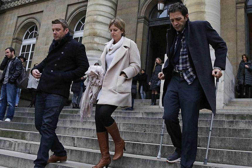 British businessman Ian Griffin (right) and his partner Tracy Baker (centre), descend the steps of the Paris courts Dec 5, 2014 during a break in proceeding in his murder trial. Griffin was jailed for 20 years by a Paris court on Friday for murdering