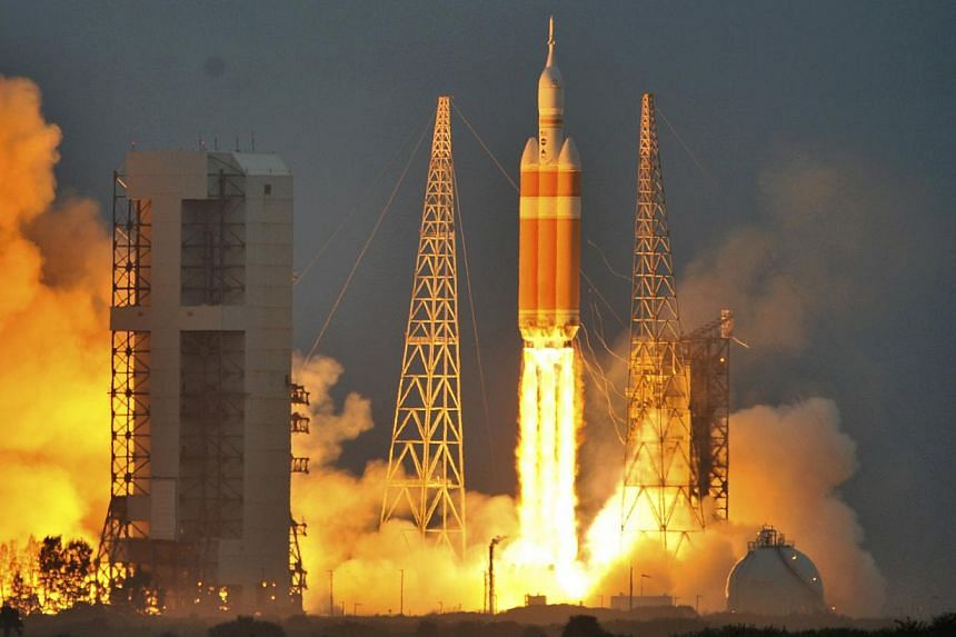 The Delta IV Heavy rocket with the Orion spacecraft lifts off from the Cape Canaveral Air Force Station in Cape Canaveral, Florida Dec 5, 2014. Nasa's unmanned Orion space capsule splashed down in the Pacific Ocean off Baja California on Friday follo