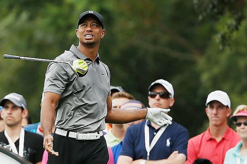 Tiger Woods watches his errant tee shot on the seventh hole during the second round of the Hero World Challenge at the Isleworth Golf & Country Club on Dec 5, 2014 in Windermere, Florida. -- PHOTO: AFP
