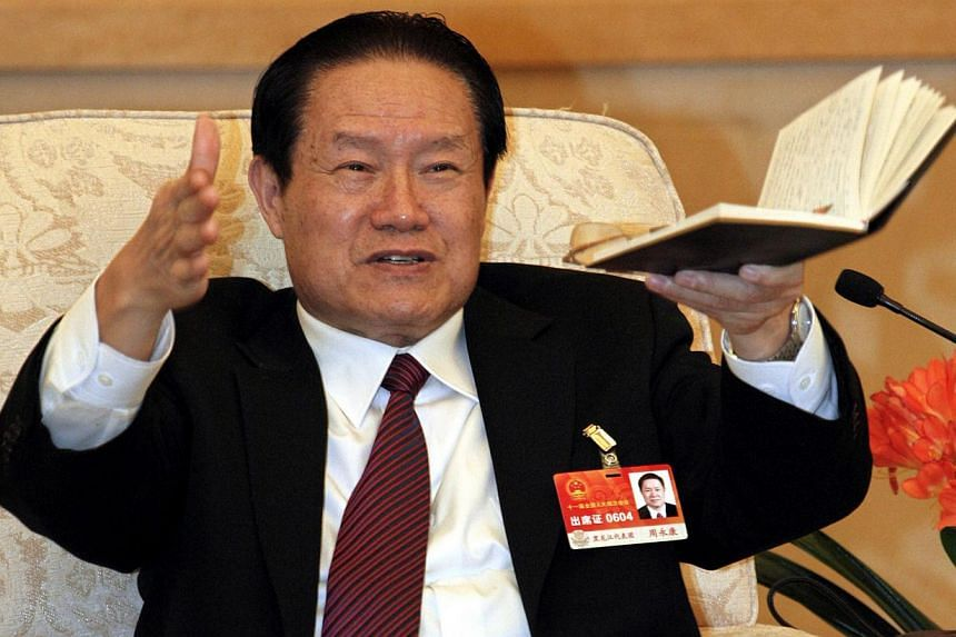Former top Communist Zhou Yongkang (above) rose through China's state oil industry to become the country's internal security chief - and amassed so much power, according to analysts, that he brought about his own downfall. -- PHOTO: REUTERS