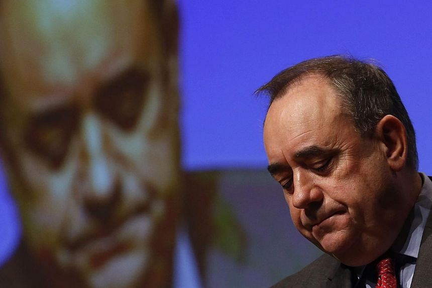 Scotland's First Minister; and now former leader of the Scottish National Party; Alex Salmond, reacts during his speech at the SNP's annual conference in Perth, Scotland, on Nov 14, 2014.Mr Salmond said on Sunday, Dec 7, that he would run for a