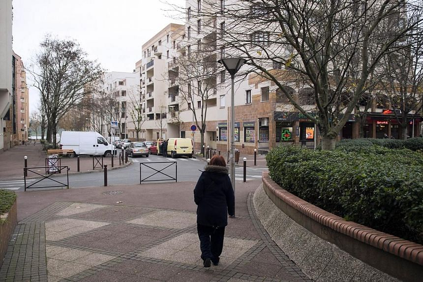"""A woman walks in a street of Creteil, outside of Paris, on Dec 4, 2014 after a violent assault targeting a Jewish couple on Dec 1, 2014.France's interior minister vowed Sunday to make the fight against anti-Semitism a """"national cause"""" after the"""