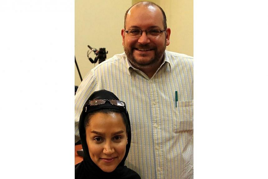 "A file picture taken on Sept 10, 2013 shows Iranian-American Washington Post correspondent Jason Rezaian and his Iranian wife Yeganeh Salehi. United States Secretary of State John Kerry said on Sunday he was ""deeply disappointed"" by reports that"
