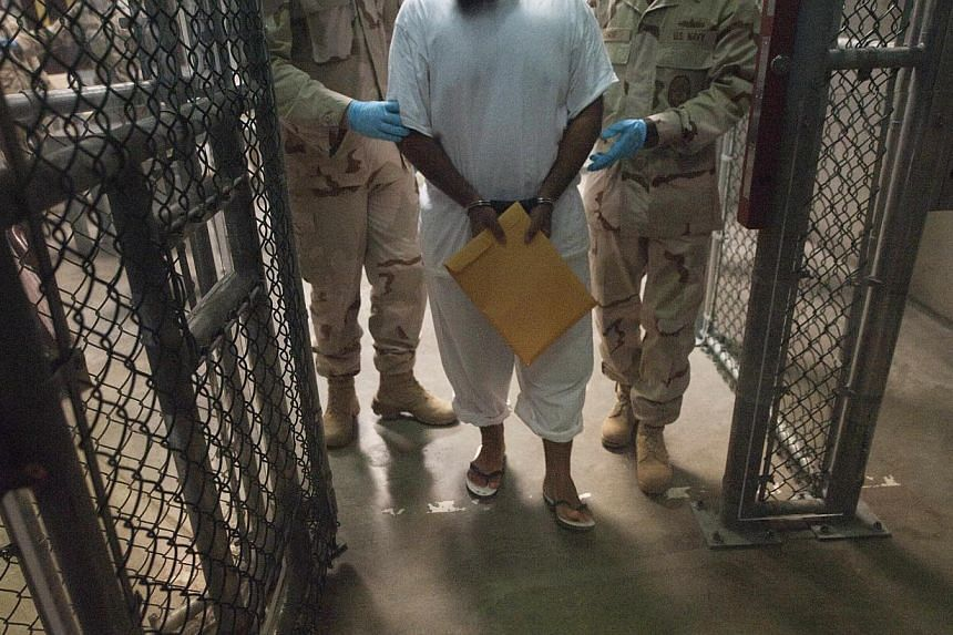 Six men held for more than a decade at the US military prison at Guantanamo Bay, Cuba, were sent to Uruguay for resettlement on Sunday, the Pentagon said, the latest step in a slow-moving effort by the Obama administration to close the facility. -- P