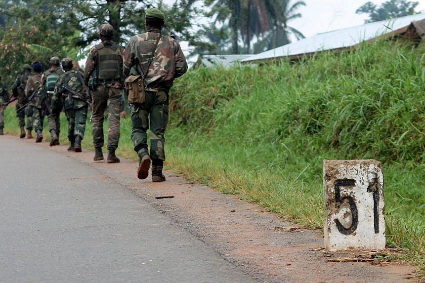 A file photo taken on Dec 31, 2013, shows Democratic Republic of Congo (FARDC) soldiers marching in Eringeti towards the front line in Beni to fight against the Allied Democratic Forces and the National Army for the Liberation of Uganda (ADF-Nalu), a
