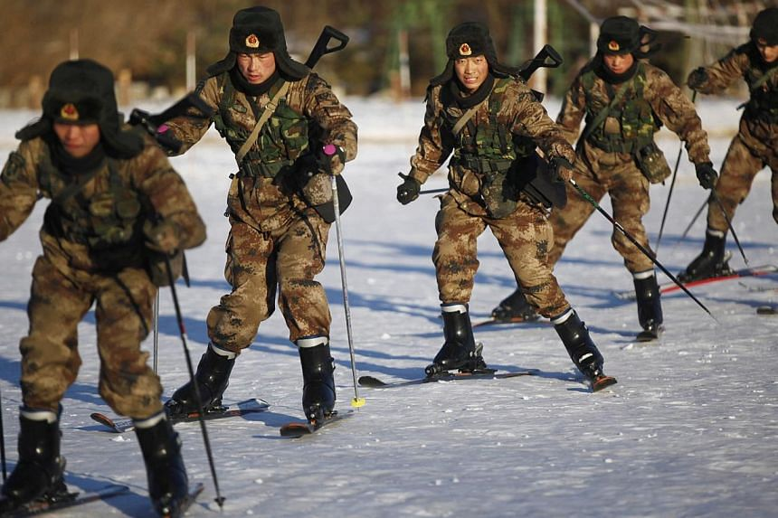 """Soldiers of China's People's Liberation Army (PLA) practice skiing in sub-zero temperatures in Heihe, Heilongjiang province, on Nov 13, 2014.An army general has warned that China will not leave the Taiwan problem """"unresolved for a long time"""", a"""