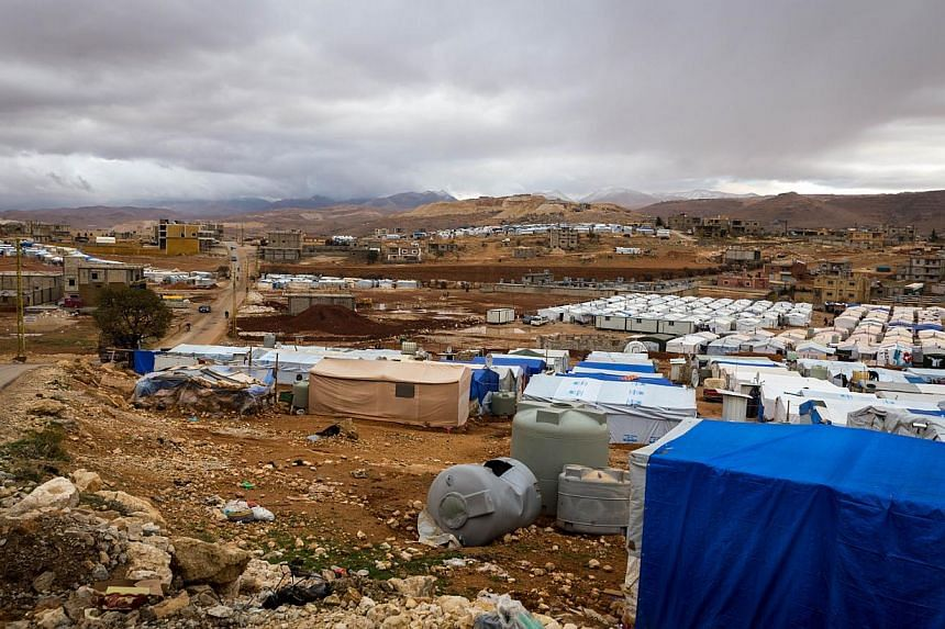 A file picture taken on Oct 23, 2014, shows the Al-Nihaya Syrian refugee camp in the Lebanese town of Arsal.Lebanese gunmen opened fire on and burned Syrian refugee tents in north Lebanon, wounding two refugees, security sources said on Sunday,
