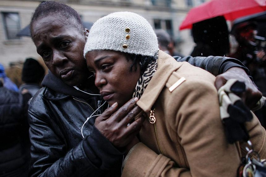 Family members of Akai Gurley attend his funeral service at the Brown Memorial Baptist Church on Dec 6, 2014 in the Brooklyn borough of New York City. Gurley was an unarmed 28-year-old man killed by New York City police officer Peter Liang in a housi