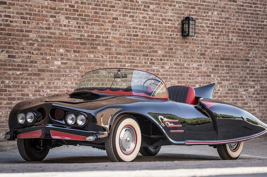 The original Batmobile (above) fetched US$137,000 (S$181,000) at auction on Saturday, a small fraction of the US$4.2 million that a buyer paid last year for another version built for the television show that aired during the 1960s. -- PHOTO: REUTERS