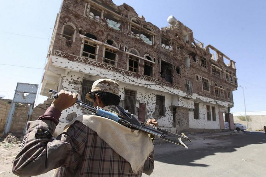 A Shi'ite Houthi rebel walks along a street in Sanaa Oct 16, 2014. It could have been something as simple as a barking dog that alerted Al-Qaeda guards as US Special Forces approached a compound in Yemen just after midnight where American journalist