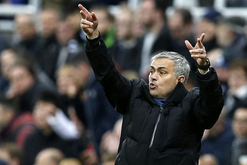 Chelsea manager Jose Mourinho gestures during their English Premier League soccer match against Newcastle United at St James' Park in Newcastle, northern England Dec 6, 2014. Mourinho accused the St James' Park ball boys of taking too long to return