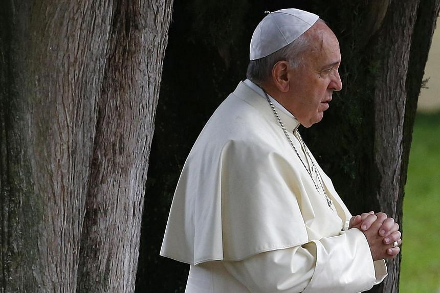 """Pope Francis (above) said Christians are being """"driven from the Middle East"""" in a message to Iraqi Christians forced to flee by Islamic State in Iraq and Syria militants. -- PHOTO: REUTERS"""